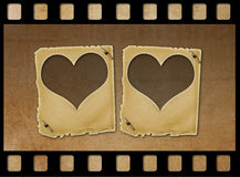 Old paper slides in the form of hearts on grunge background. Old paper slides in the form of hearts on abstract grunge background Royalty Free Stock Photos