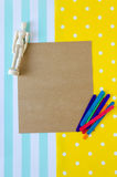Old paper and small puppet. Old paper with puppet and colored wooden sticks on the colorful background Stock Photo
