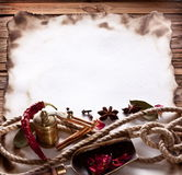 Old paper with spices Royalty Free Stock Photography