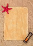 Old paper, starfishes and hourglasses Stock Photos