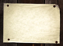 Old paper tacked to a wood wall Stock Images