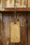 Old paper tag with string hanged on on hook Royalty Free Stock Photo