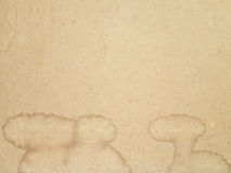 Old paper texture with aged blots. Wet royalty free stock images