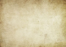 Old paper texture. Aged and yellowed paper background for the design royalty free stock photos