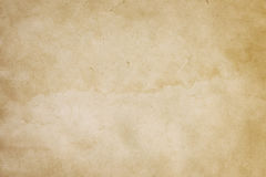 Old paper texture. Aging stained paper background for the design royalty free stock photo