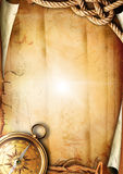 Old paper texture with a compass and rope Royalty Free Stock Image