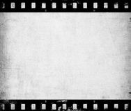 Old paper texture with film strip. Old paper texture close up Stock Photo
