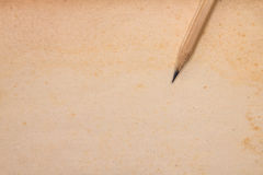 Old paper texture with part of wooden pencil Royalty Free Stock Image