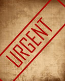 Old paper texture with 'urgent' Royalty Free Stock Image