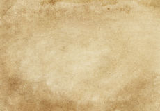 Old paper texture. Old and yellowed paper background for the design. Grunge style stock images