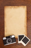 Old paper and vintage photo frame with camera Royalty Free Stock Photos