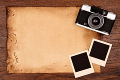 Old paper and vintage photo frame with camera Royalty Free Stock Photo