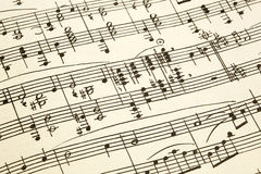 Old paper with vintage sheet music.  Stock Image