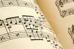 Old paper with vintage sheet music.  Royalty Free Stock Photos