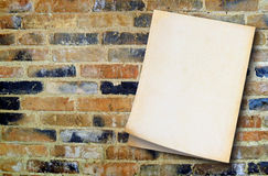 Old paper on vintage wall background. (with space for text Royalty Free Stock Image