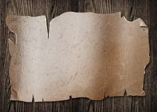 Old paper on wood. Royalty Free Stock Photography