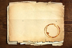 Old paper on wood. Texture old paper with coffee mark on wood royalty free stock image
