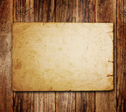 Old paper on the wood Royalty Free Stock Photography