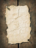 Old paper on the wood Royalty Free Stock Image