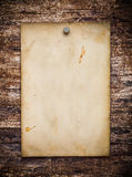 Old paper on the wood. Background Royalty Free Stock Photo