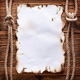 Old paper on wood background. Stock Photos