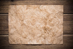 Old paper. On the wood background royalty free stock image