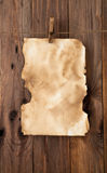 Old paper. On the wood background royalty free stock photography