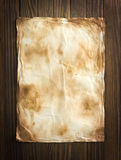 Old paper on the wood background.  Royalty Free Stock Photos