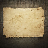 Old paper on the wood background.  Stock Photos