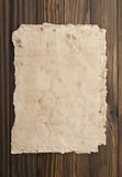 Old paper on the wood background.  Royalty Free Stock Photo