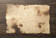 Old paper on the wood background Royalty Free Stock Photos