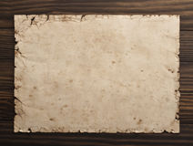 Old paper on the wood background.  Stock Images