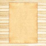Old paper on wood. Background royalty free stock images