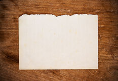 Old paper on wood background. Close up old paper on a wood background Royalty Free Stock Images