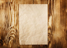 Old paper. On the wood background. Frame stock images