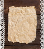 Old paper on the wood background Stock Images
