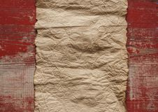 Old paper on the wood background. Old blank parchment on aged wood background royalty free stock photo