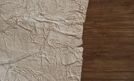 Old paper on the wood background. Old blank parchment on aged wood background royalty free stock photography