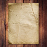 Old paper on wood background. And texture Royalty Free Stock Photos