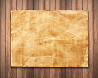 Old paper on wood background texture.  Royalty Free Stock Photography