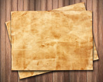 Old paper on wood background texture.  Royalty Free Stock Photo