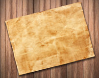 Old paper on wood background texture.  Royalty Free Stock Photos