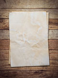 Old paper on wood background Royalty Free Stock Photo