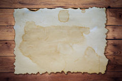 Old paper on wood background and texture. With space Stock Photography