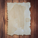 Old paper on wood background and texture. With space Royalty Free Stock Photography