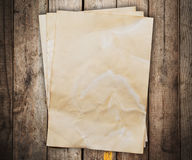 Old paper on wood background and texture. With space Stock Photos