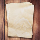Old paper on wood background and texture. With space Royalty Free Stock Image