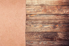 Old paper on the wood. Old paper on the brown wood background stock image