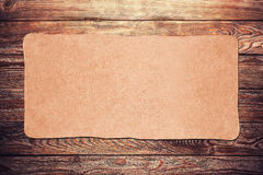 Old paper on the wood. Old paper on the brown wood background stock photography