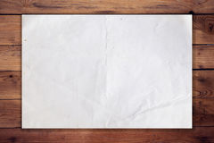 Old paper on wood horizontal background Stock Images